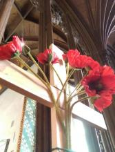 Wooden Cross adorned with poppies